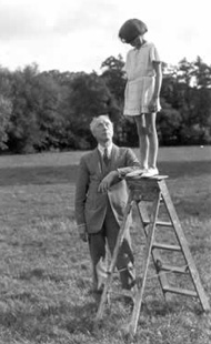F M Alexander with a child on a ladder
